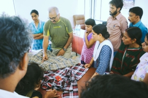 Pallav teaching about garment quality checks.