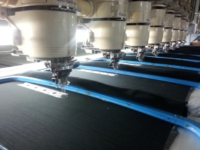Row of automated sewing machines.