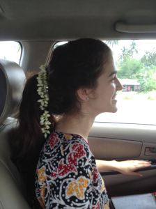 Our new fashionable hairstyle includes flowers brought from a local vendor