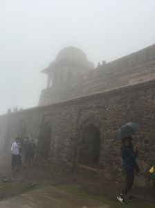 Roopmati's Pavilion through the thick fog and monsoon rains.
