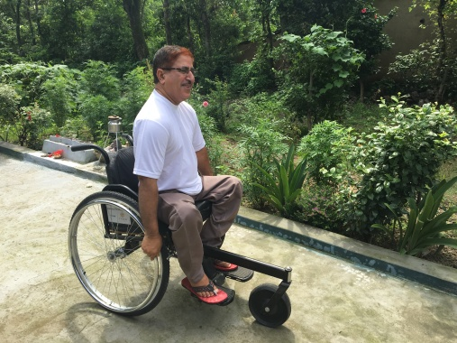 "Mahindar Singh, 50 yr. old spinal injury patient with his CORD sponsored ""Motivation Tricycle"""
