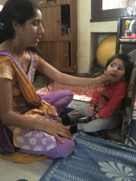 Ritu, 2 yr. old with Cerebral Palsy and Mental Retardation, and her mother who stay in a rented home and come to the CORD center throughout the week for therapy