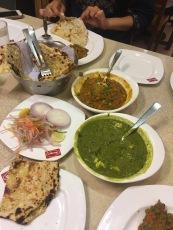 Kulcha, naan, palak paneer, and mixed vegetable curry!
