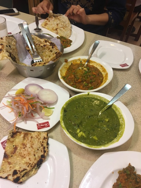 Kulcha, naan, palak paneer, and mixed vegetable curry!